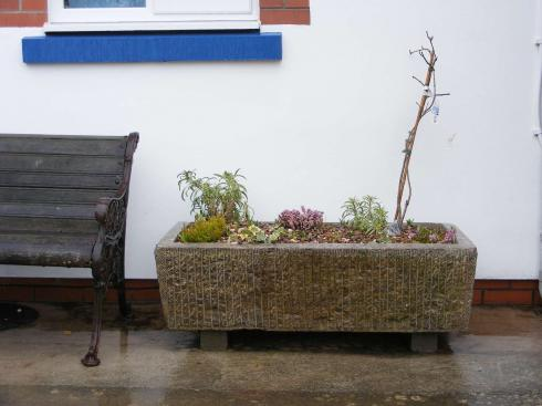 Old stone trough for Coxley Primary School