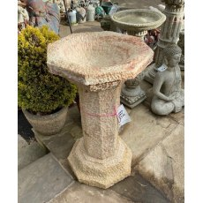 Carved natural stone birdbath