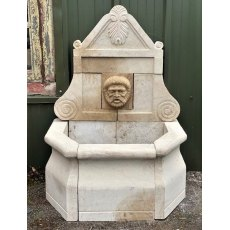 Hand carved natural stone wall fountain