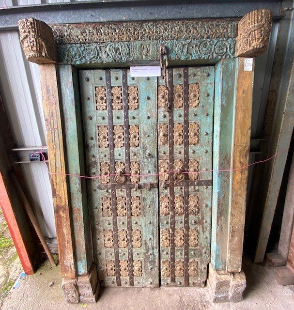 Vibrant carved late 1800's Teak doors